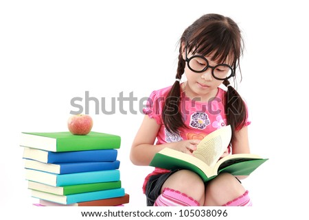 student little asian girl reading a book