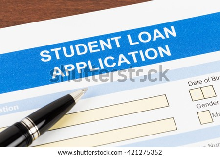 Student loan application form with pen