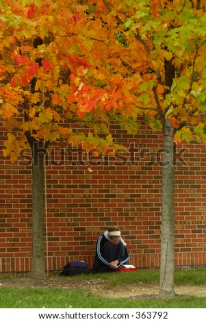 Student on College Campus in Autumn - stock photo