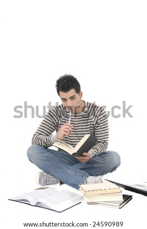 student on the floor reading his books - stock photo