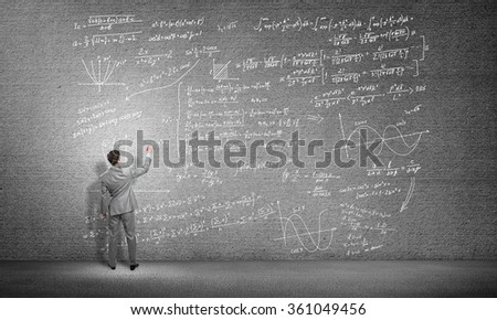 Student or teacher at blackboard - stock photo