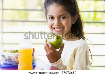 Student outdoors eating lunch (selective focus) - stock photo