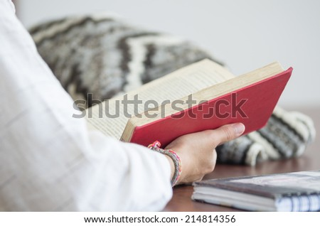 student reading a book in library selective focus - stock photo