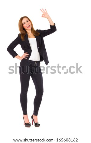 Student showing ok sign. Full length studio shot isolated on white. - stock photo