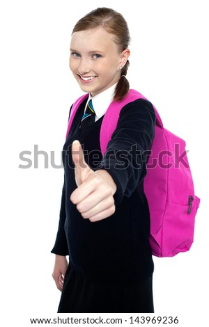 Student showing thumbs up gesture - stock photo