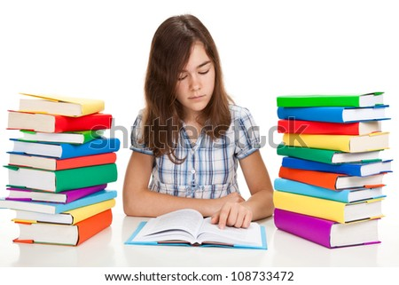 Student sitting close to pile of books on white background