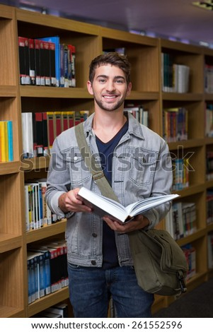 Student smiling at camera in library at the university