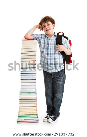 Student standing close to pile of books on white background  - stock photo
