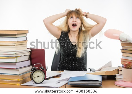 Student tears his hair out of nervous tension - stock photo
