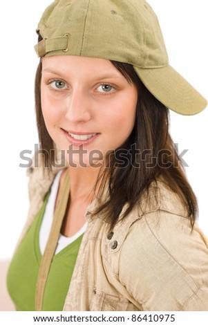 Student teenager girl with baseball cap posing looking at camera - stock photo