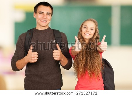 Student. Teenagers Giving the Thumbs Up - Isolated - stock photo