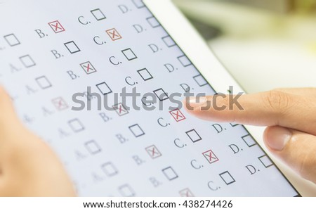 student testing in exercise, exams answer on a tablet with multiple-choice questions of e-learning by finger clicking : education concept - stock photo