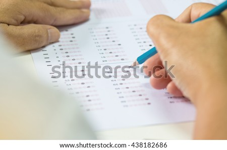 student testing in exercise, exams answer sheets or test paper with pencil, : education concept