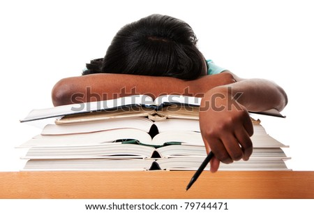Student tired of doing homework studying with pen asleep on open books, isolated. - stock photo