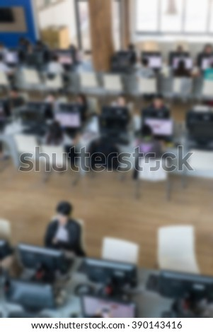 student use computer to access to internet for education in university (blurry defocused image)
