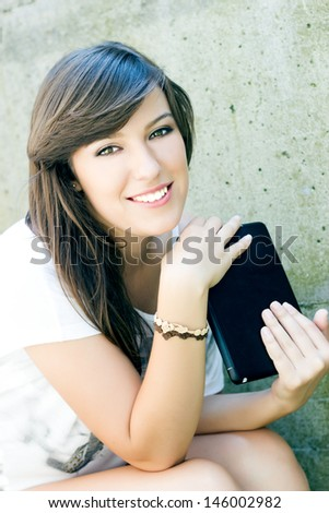 Student using digital tablet - stock photo