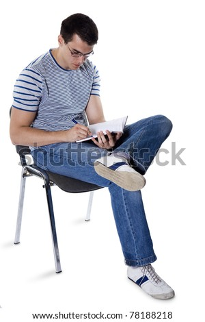 Student with a notebook sits on a chair isolated a white background - stock photo