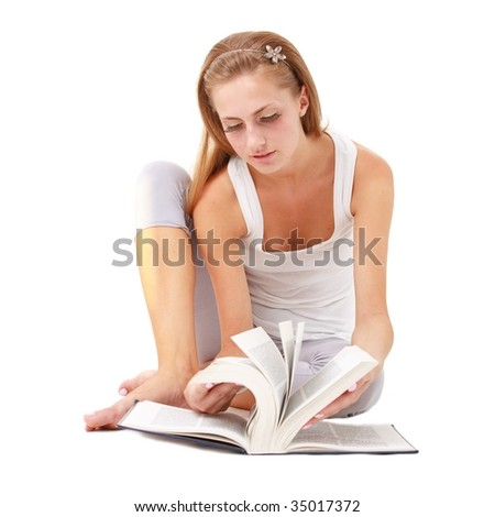 Student with big book sitting on a white background
