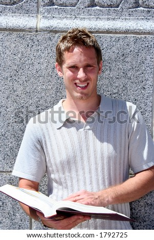 Student with book - stock photo