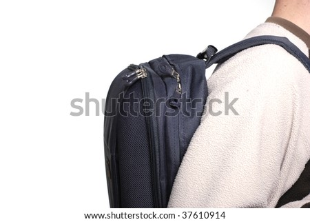 Student with laptop backpack and plenty of copy space. - stock photo