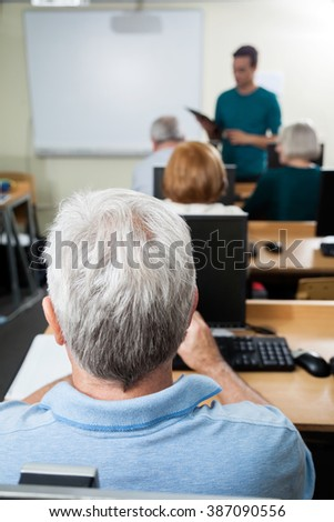 Student With Male Teacher In Computer Class