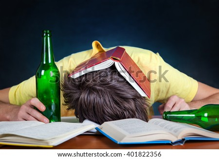 Student with the Beer sleep on the Books - stock photo