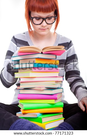 student  with trendy hairstyle reading book, isolated on white background - stock photo