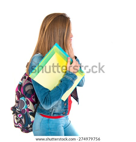 Student woman doing surprise gesture over white background   - stock photo