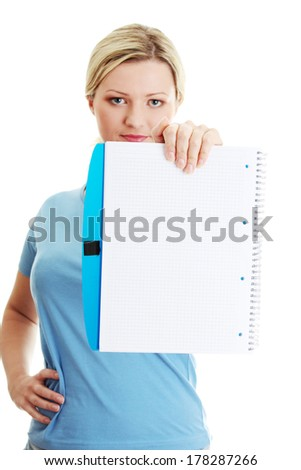 Student woman holding blank copybook. Isolated on white background.  - stock photo