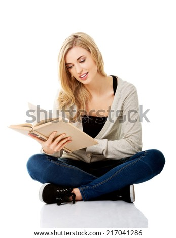 Student woman with book in hand