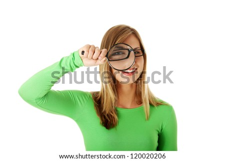 Student woman with magnifying glass isolated on white - stock photo