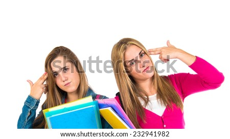 Student women making suicide gesture over white background - stock photo