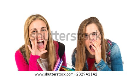 Student women shouting over isolated white background - stock photo