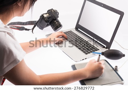 student working on a laptop computer- isolated over a white background  - stock photo