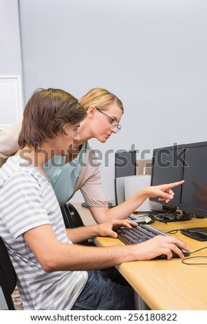Student working on computer in classroom at the university - stock photo