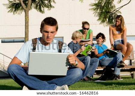student working on laptop - stock photo