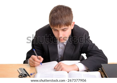 Student writing at the School Desk Isolated on the White Background - stock photo