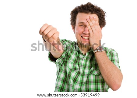 student, young adult showing thumb down gesture, but smiling and looks happy, isolated on white background