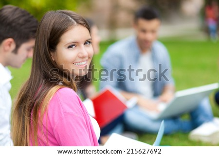 Students at the park - stock photo