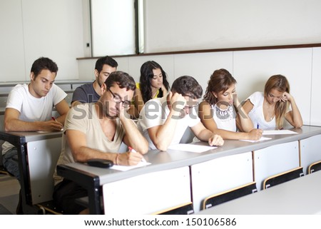 students at the university in class room - stock photo