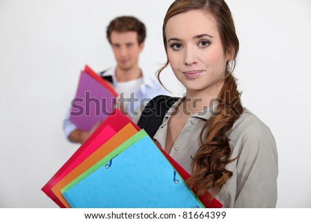 Students carrying folders - stock photo