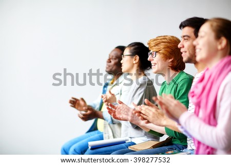 Students clapping hands - stock photo