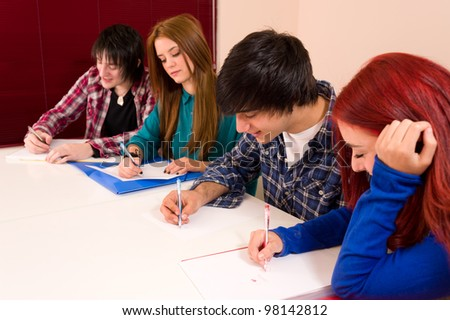 Students concentrated on their work - stock photo