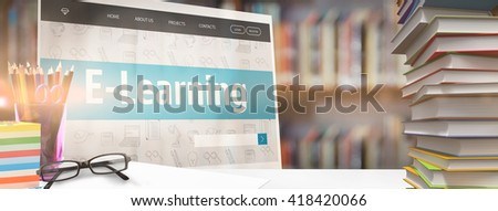 Students desk against library shelf - stock photo