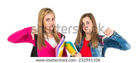 Students doing bad signal over white background - stock photo