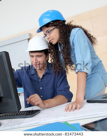 Students engineers working on project - stock photo