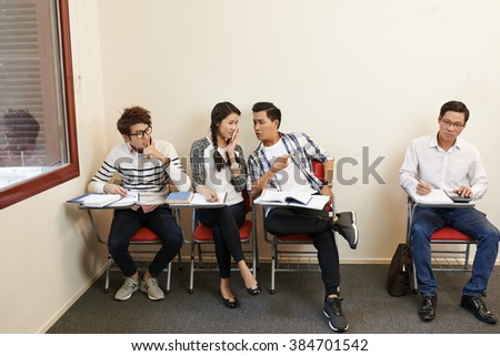 Students gossiping about their middle-aged classmate
