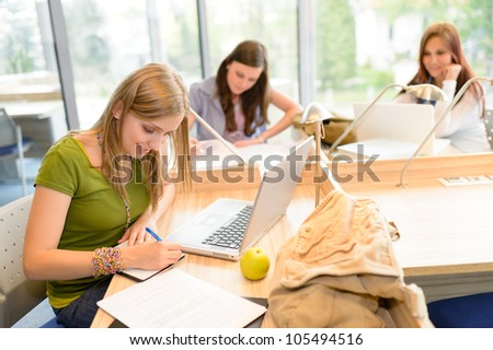 Students group working on computer at study room high school - stock photo
