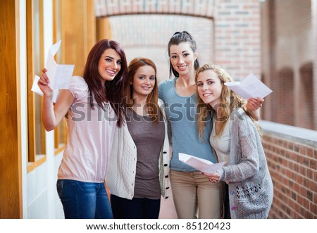 Students having their results in a corridor - stock photo