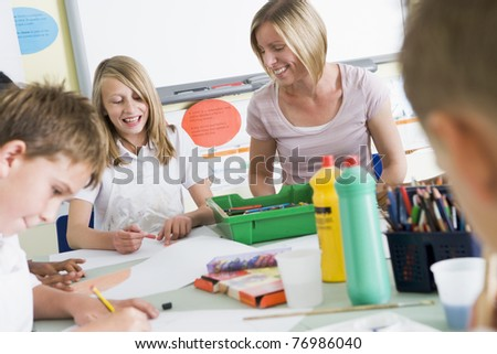Students in art class with teacher - stock photo